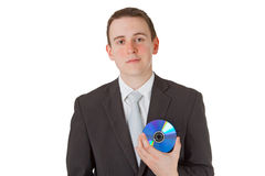 Businessman with memory disk Stock Images