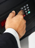 Businessman mens hand opens a safe Stock Photography