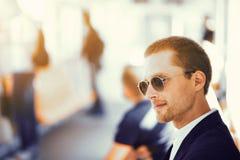 Businessman in metro train. stock photography