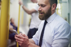 Businessman in metro Stock Photo