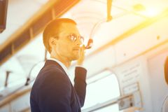 Businessman in metro train. stock photos