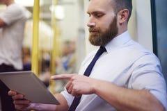 Businessman in metro Stock Images