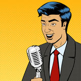Businessman with microphone pop art vector Royalty Free Stock Photo