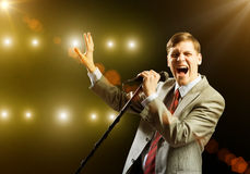 Businessman with microphone Royalty Free Stock Photography