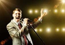 Businessman with microphone Stock Image
