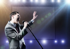 Businessman with microphone Royalty Free Stock Photo
