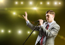 Businessman with microphone Stock Images