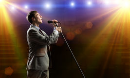 Businessman with microphone Royalty Free Stock Photos