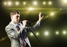 Businessman with microphone Royalty Free Stock Images