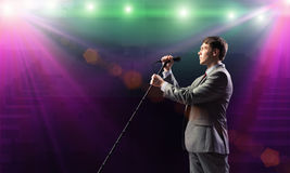 Businessman with microphone Stock Photography