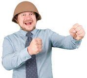 Businessman in military helmet fighting Royalty Free Stock Photos