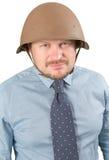 Businessman in military helmet fighting Stock Photos
