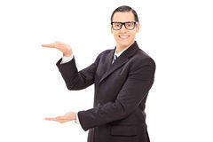 Businessman mimicking with hands Stock Photo