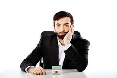 Businessman with a mini house in the office. Royalty Free Stock Photography
