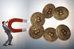 The businessman mining bitcoins with horseshoe magnet. Businessman mining bitcoins with horseshoe magnet Royalty Free Stock Photography