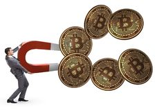 The businessman mining bitcoins with horseshoe magnet. Businessman mining bitcoins with horseshoe magnet Stock Images