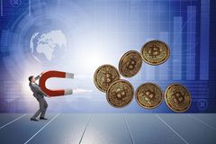 The businessman mining bitcoins with horseshoe magnet. Businessman mining bitcoins with horseshoe magnet Royalty Free Stock Photo