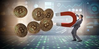 The businessman mining bitcoins with horseshoe magnet. Businessman mining bitcoins with horseshoe magnet Royalty Free Stock Images