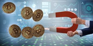 The businessman mining bitcoins with horseshoe magnet Royalty Free Stock Photos