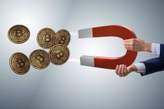 The businessman mining bitcoins with horseshoe magnet Stock Photography