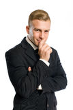 Businessman with mischievous smile. Portrait of a confident young businessman with mischievous smile Royalty Free Stock Photography