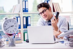 The businessman missing deadline for deliverables in office Stock Image