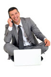 Businessman with mobile and laptop Royalty Free Stock Photography