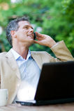 Businessman on mobile outdoor Royalty Free Stock Photos