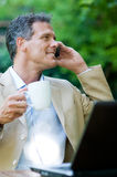 Businessman on mobile outdoor Royalty Free Stock Photography