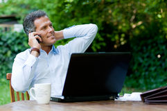 Businessman on mobile outdoor Stock Images