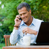 Businessman on mobile outdoor Stock Photography