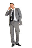 Businessman with mobile phone. In white background stock photography