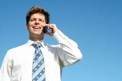 Businessman with mobile phone Stock Images