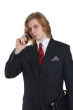 Businessman with mobile phone. Half body portrait of handsome young businessman with mobile telephone and briefcase, isolated on white background Royalty Free Stock Photo