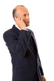 Businessman with mobile phone. Businessman talking on the mobile phone. isolated on white Stock Photography