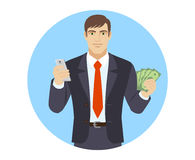 Businessman with mobile phone and cash money Royalty Free Stock Photo