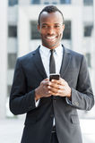 Businessman with mobile phone. Stock Photography