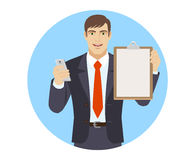 Businessman with mobile phone and clipboard Stock Image