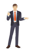 Businessman with mobile phone gesturing Stock Photos