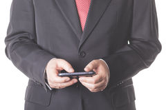Businessman. With mobile phone in hand Royalty Free Stock Images