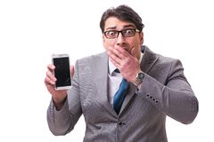 The businessman with mobile phone isolated on white. Businessman with mobile phone isolated on white stock photography