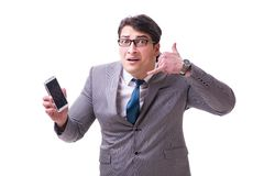The businessman with mobile phone isolated on white. Businessman with mobile phone isolated on white royalty free stock photos