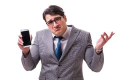 The businessman with mobile phone isolated on white. Businessman with mobile phone isolated on white royalty free stock image