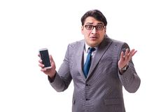 The businessman with mobile phone isolated on white. Businessman with mobile phone isolated on white stock image
