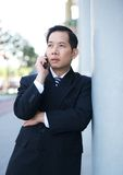 Businessman on mobile phone outdoors Stock Photo