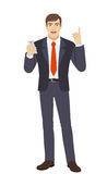 Businessman with mobile phone pointing up Royalty Free Stock Photos