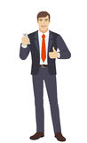 Businessman with mobile phone showing the thumb up Stock Photos