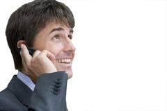 Businessman on mobile phone, smiling, close-up, cut out Stock Images