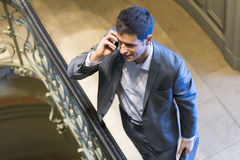 Businessman on mobile phone in staircase. seen from above Stock Image