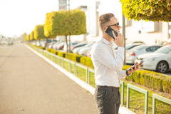 Businessman with mobile phone and tablet in hands Stock Photography